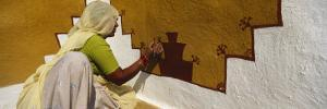 Woman Painting on a Wall, Thar Desert, Jaisalmer, Rajasthan, India