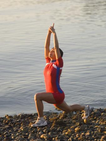 Woman Practicing Yoga on the Riverside, Bainbridge Island, Washington State, USA