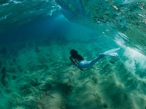 Woman Pretending to Be a Mermaid Swimming Underwater, Hawaii, USA