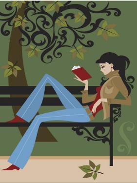 Woman Reading Book on Park Bench