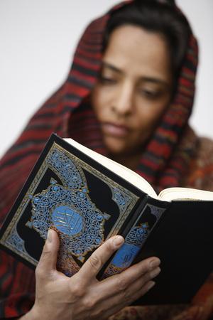 https://imgc.allpostersimages.com/img/posters/woman-reading-koran-jordan_u-L-Q1GYMKS0.jpg?artPerspective=n