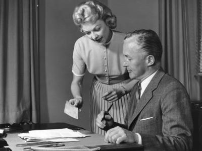 Woman Showing Man Cheque, Man Holding Pen