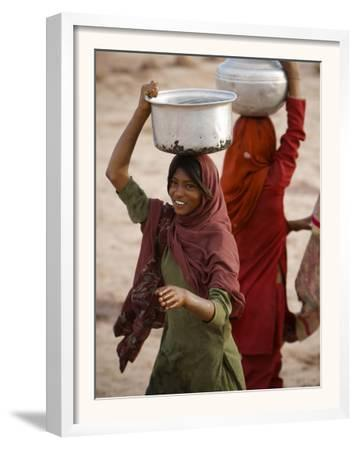Woman Smiles after Collecting Drinking Water, on the Outskirts of Islamabad, Pakistan