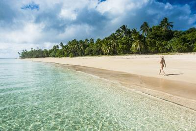 https://imgc.allpostersimages.com/img/posters/woman-walking-on-a-palm-fringed-white-sand-beach-in-ha-apai-islands-tonga-south-pacific_u-L-Q12T1Q20.jpg?artPerspective=n