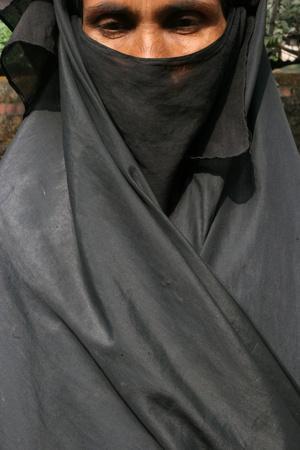 https://imgc.allpostersimages.com/img/posters/woman-wearing-a-black-islamic-burqa-bariali-gazipur-bangladesh_u-L-Q1GYKMH0.jpg?artPerspective=n