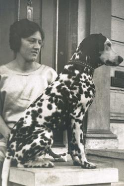 Woman with Dalmatian Outside a House