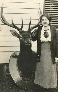Woman with Mounted Deer Head