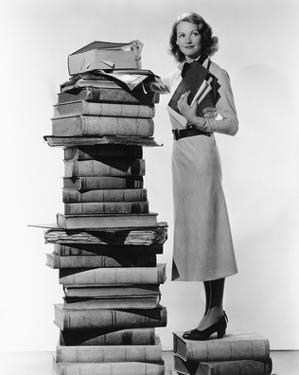 Woman With Pile Of Large Books