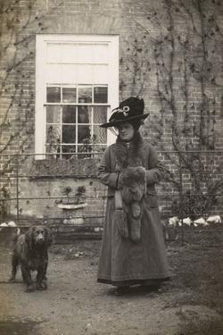 Woman with Spaniel Dog Outside a House