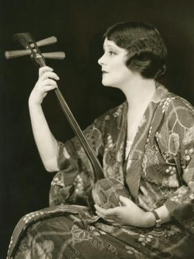 Woman with String Instrument