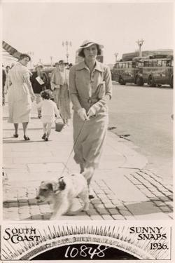 Woman with Terrier on a Lead at the Seaside