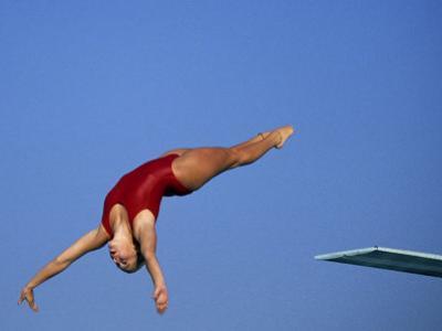 Women Diver Flying Through the Air