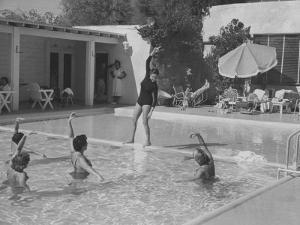 Women in Tank Suits Pool Excercising at Elizabeth Arden's Reducing Resort in Arizona