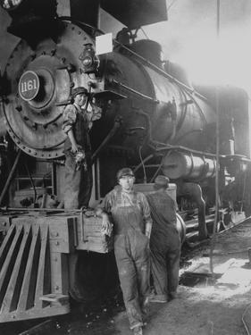 Women Rail Workers Standing at Work on Engine of Train, During WWI at Great Northern Railway