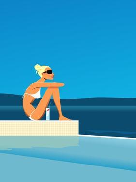 Women Sitting by Swimming Pool near Ocean