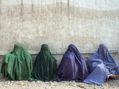 Women Wearing Burquas Wait to be Received at a Clinic