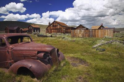https://imgc.allpostersimages.com/img/posters/wood-buildings-and-old-car-bodie-state-historic-park-california-usa_u-L-PXR9GS0.jpg?artPerspective=n