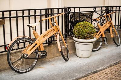 https://imgc.allpostersimages.com/img/posters/wooden-bicycles-in-amsterdam_u-L-Q11UR2S0.jpg?artPerspective=n