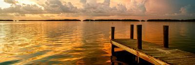 https://imgc.allpostersimages.com/img/posters/wooden-jetty-at-sunset_u-L-PZ5DTI0.jpg?artPerspective=n
