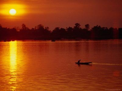 Fisherman Heading Out for Night Fishing Under Mekong River Sunset, Si Phan Don, Laos