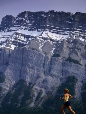 Woman Running in Front of Mountain, Banff, Canada