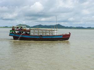 Work boat on Kaladan River, Rakhine State, Myanmar