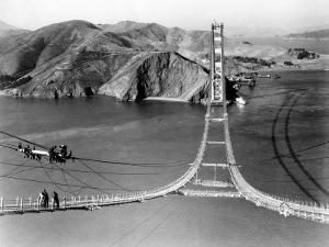 Workers Complete the Catwalks for the Golden Gate Bridge