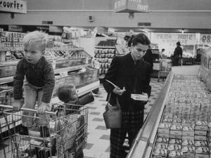 Working Mother Jennie Magill Shopping with Her Children at the Super Market