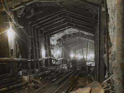 https://imgc.allpostersimages.com/img/posters/workmen-in-tunnel_u-L-PZONLU0.jpg?p=0