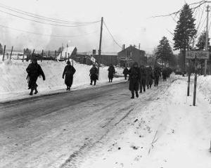 World War II, Us Army Infantrymen March on a Road Near Bastogne, Belgium. Dec 1944
