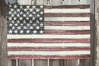 https://imgc.allpostersimages.com/img/posters/worn-wooden-american-flag-fire-island-new-york_u-L-Q12T1PS0.jpg?p=0