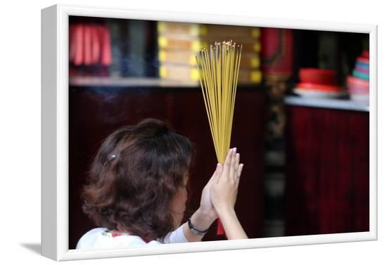 Worshipper burning incense sticks, Taoist temple, Phuoc An Hoi Quan Pagoda-Godong-Framed Photographic Print