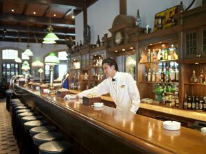 Bartender Wipes the Bar Counter in Raffles Hotel, Singapore by xPacifica