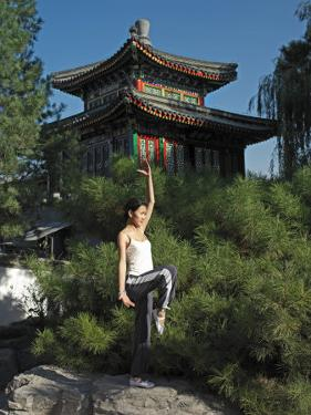 Chinese Woman in Her 20s to 30s Doing Yoga at the Forbidden City by xPacifica