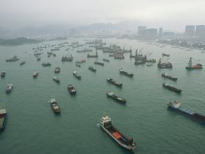 Container Ships in Hong Kong Harbor Waiting for Cargo to Be Loaded by xPacifica