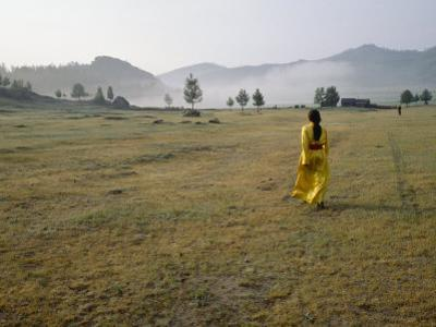 Female Shaman Walks across Grass in a Bright Yellow Silk Robe by xPacifica