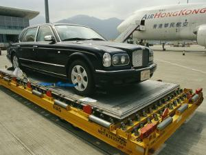 Luxury Bentley Unloaded from an Airplane at Chek Lap Kok Airport by xPacifica