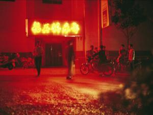 Motorcyclists outside a Karaoke Bar with a Neon Sign in Hunan by xPacifica