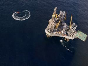 Oil Rig and Safety Boat in the North Atlantic Ocean by xPacifica