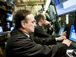 Securities Traders at a Trading Post at the New York Stock Exchange by xPacifica