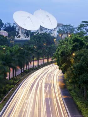 Traffic Rushes Past the Bukit Timah Satellite Earth Station at Night by xPacifica