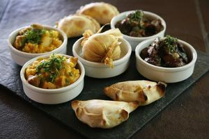 A Tray with Traditional Food from the Northwest by Yadid Levy