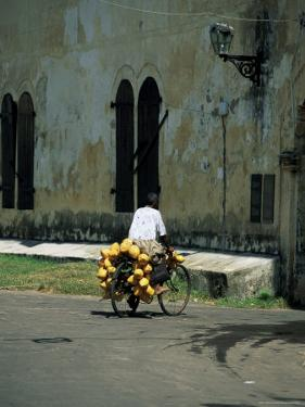 Coconut Seller Riding His Bicycle, Galle, Sri Lanka by Yadid Levy