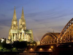 Cologne Cathedral, and Hohenzollern Bridge at Night, North Rhine Westphalia by Yadid Levy