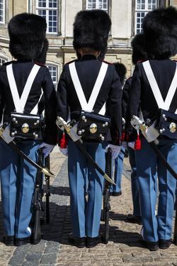 Guards at Amalienborg Royal Palace, Copenhagen, Denmark, Scandinavia, Europe by Yadid Levy