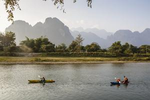 People Kayaking on the Nam Song River, Vang Vieng, Laos, Indochina, Southeast Asia, Asia by Yadid Levy