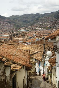 Street Scene in San Blas Neighbourhood with a View over the Rooftops of Cuzco, Peru, South America by Yadid Levy