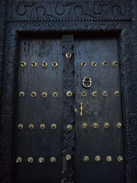 Traditional Carved Wooden Door in Stone Town, Zanzibar, Tanzania, East Africa, Africa by Yadid Levy