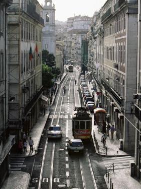 Traffic in the Baixa Area, Lisbon, Portugal by Yadid Levy