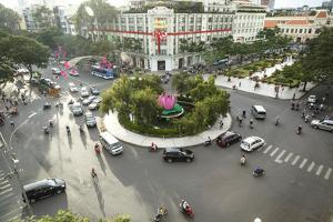 Traffic Intersection Nguyen Hue Boulevard and Le Loi Boulevard, Ho Chi Minh City (Saigon), Vietnam by Yadid Levy